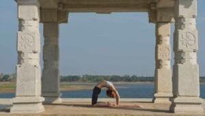 Susan Hounsell, Level 2 Authorised Ashtanga Yoga teacher in Susan Kapotasana beside the Kabini River, Mysore India