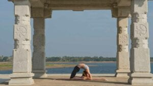 Susan Hounsell, Level 2 Authorised Ashtanga Yoga teacher in Susan Kapotasana beside the Kabini River, Mysore India
